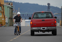 Man on bicycle in industrial site
